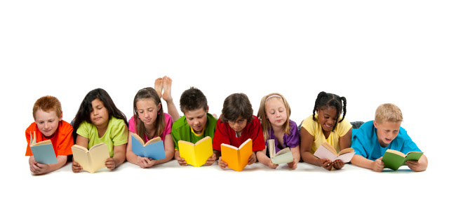 A group of diverse children reading a book.